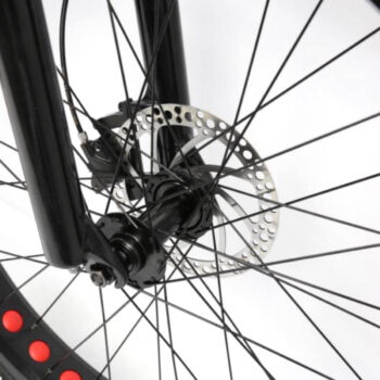 closeup of front wheel and brakes on electric bike by Hardcore eCycles